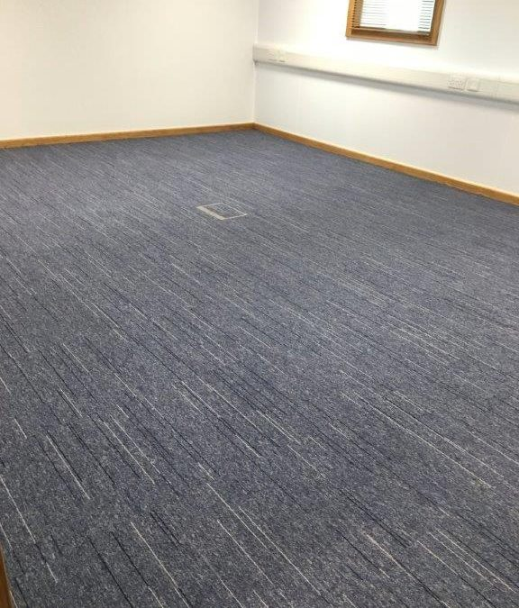 Striped carpet tile to offices